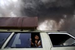 Beawiharta Beawiharta, luglio 2015.Ramadinah Milala,8 anni,e la sua famiglia scappano dalla loro casa a causa dell'eruzione del vulcano Sinabung sull'isola di Sumatra,Indonesia.Nella fuga, hanno dovuto abbandonare tutto,anche mucca e gatto